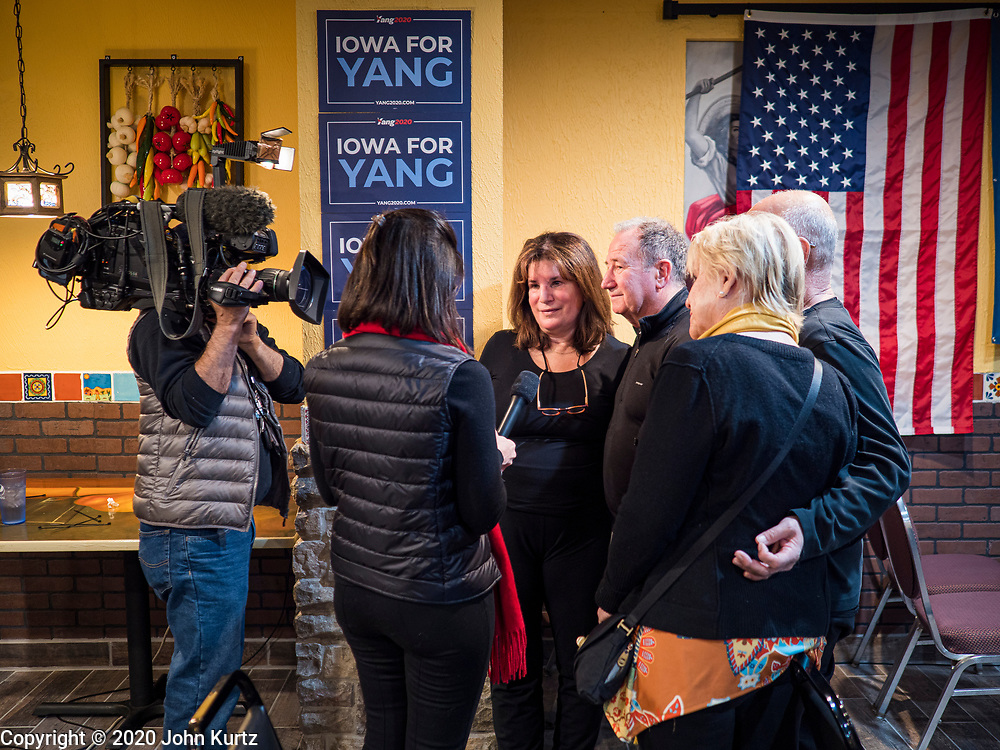 02 FEBRUARY 2020 - BOONE, IOWA: Journalists from CBS News interview Iowans at an Andrew Yang campaign event. More than 150 people crammed into a banquet room at La Carreta, a Mexican restaurant in Boone to see Andrew Yang on one of his last campaign events before the Iowa Caucuses. Yang, an entrepreneur, is running for the Democratic nomination for the US Presidency in 2020. He is in central Iowa finishing his 17 day bus tour across the state. Iowa hosts the the first election event of the presidential election cycle. The Iowa Caucuses will be on Feb. 3, 2020.      PHOTO BY JACK KURTZ