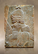 Stone relief sculptured panel fragment of a Genie blessing. Inv AO 19864/19880 from Dur Sharrukin the palace of Assyrian king Sargon II at Khorsabad, 713-706 BC.  Louvre Museum Room 4 , Paris .<br /> <br /> If you prefer to buy from our ALAMY PHOTO LIBRARY  Collection visit : https://www.alamy.com/portfolio/paul-williams-funkystock/ancient-assyria-antiquities.html  Refine search by adding background colour, place, subject, museum etc into the LOWER SEARCH WITHIN GALLERY box to <br /> <br /> Visit our ANCIENT WORLD PHOTO COLLECTIONS for more photos to download or buy as wall art prints https://funkystock.photoshelter.com/gallery-collection/Ancient-World-Art-Antiquities-Historic-Sites-Pictures-Images-of/C00006u26yqSkDOM