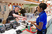 Tiffany Whitehead, a student and part-time ride supervisor at the Mall of America amusement park, buys lunch from a fast food outlet at the Mall of America in Bloomington, Minnesota. (Featured in the book What I Eat: Around the World in 80 Diets.) MODEL RELEASED.