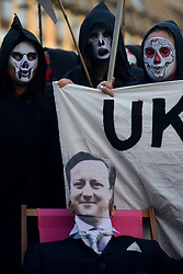 © Licensed to London News Pictures.02/11/2013. London, UK. Amnesty supporters dressed as grim reapers accompanied by Prime Minister David Cameron lookalike demonstrator gather in Parliament Square to protest UK government endorsement of Sri Lanka at next week's Commonwealth Heads of Government Meeting (CHOGM) in Colombo.Photo credit : Peter Kollanyi/LNP