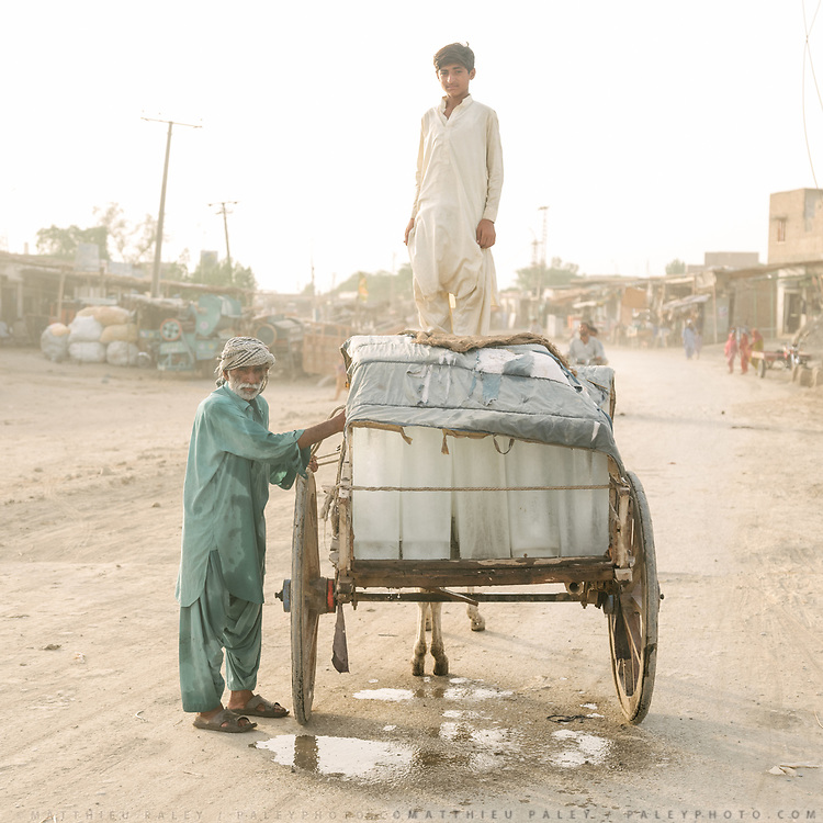 A donkey cart loaded with ice packs leaves an ice factory to sell ice throughout town. With regular rolling blackouts, failure, one way of cooling water is to simply use ice. It is 48 degrees C.