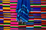 Mexican blankets for sale at the Glastonbury Festival <br /> Glastonbury Festival is the largest greenfield festival in the world, and is now attended by around 175,000 people. It's a five-day music festival that takes place near Pilton, Somerset, England. In addition to contemporary music, the festival hosts dance, comedy, theatre, circus, cabaret, and other arts. It is organised by Michael Eavis on his own land, Worthy Farm in Pilton. Leading pop and rock artists have headlined, alongside thousands of others appearing on smaller stages and performance areas.