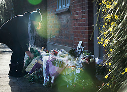 © Licensed to London News Pictures. 26/12/2016. Goring-, UK. A fan of George Michael places a floral tribute at his front door. Pop superstar George Michael died on Christmas day at his Oxfordshire home on the River Thames aged 53. Photo credit: Peter Macdiarmid/LNP