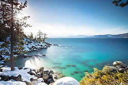 """""""Boulders at Lake Tahoe 50"""" - Long exposure (331 seconds) photograph of snow covered boulders and the blue waters of Lake Tahoe, just north of Sand Harbor."""