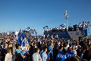 Fans walk alongside the open top bus during the Brighton & Hove Albion Football Club Promotion Parade at Brighton Seafront, Brighton, East Sussex. United Kingdom on 14 May 2017. Photo by Ellie Hoad.