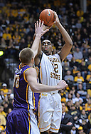 WICHITA, KS - JANUARY 05:  Forward Darius Carter #12 of the Wichita State Shockers puts up a shot over forward Seth Tuttle #10 of the Northern Iowa Panthers during the first half on January 5, 2014 at Charles Koch Arena in Wichita, Kansas.  Wichita State defeated Northern Iowa 67-53. (Photo by Peter Aiken/Getty Images) *** Local Caption *** Darius Carter;Seth Tuttle