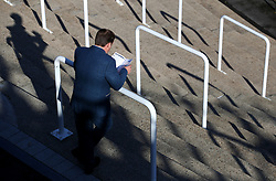 General view of spectators reading the program during day one of the Showcase at Cheltenham Racecourse