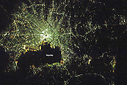 City's By Night<br /> <br /> The night lights of Tokyo Bay, Japan,<br /> <br /> Cities from different regions of the Earth are also identified by differences in their nighttime lights. Japanese cities glow a cooler blue-green than other regions of the world. Newer developments along the shore of Tokyo Bay are characterized by orange sodium vapor lamps, while the majority of the urban area has light green mercury vapor lamps.<br /> ©Earth Observatory/Exclusivepix