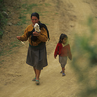 Village woman spins wool.