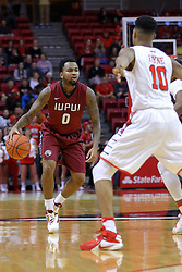 26 November 2016: Darell Combs defended by Phil Fayne(10) during an NCAA  mens basketball game between the IUPUI Jaguars the Illinois State Redbirds in a non-conference game at Redbird Arena, Normal IL