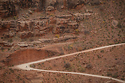 SHOT 10/17/16 11:27:27 AM - A mountain biker climbs the Shafer Trail section of the White Rim Trail. The White Rim is a mountain biking trip in Canyonlands National Park just outside of Moab, Utah. The White Rim Road is a 71.2-mile-long unpaved four-wheel drive road that traverses the top of the White Rim Sandstone formation below the Island in the Sky mesa of Canyonlands National Park in southern Utah in the United States. The road was constructed in the 1950s by the Atomic Energy Commission to provide access for individual prospectors intent on mining uranium deposits for use in nuclear weapons production during the Cold War. Four-wheel drive vehicles and mountain bikes are the most common modes of transport though horseback riding and hiking are also permitted.<br /> (Photo by Marc Piscotty / © 2016)