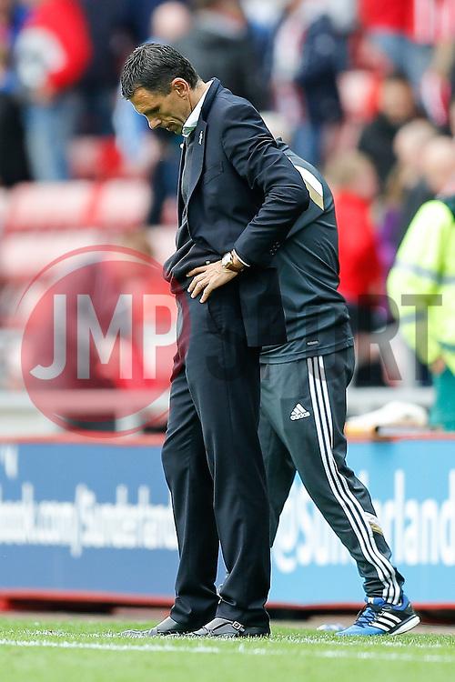 Manager Gustavo Poyet of Sunderland looks dejected after the game ends 1-1 - Photo mandatory by-line: Rogan Thomson/JMP - 07966 386802 - 27/08/2014 - SPORT - FOOTBALL - Sunderland, England - Stadium of Light - Sunderland v Swansea City - Barclays Premier League.