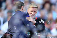 Eddie Howe, the Bournemouth manager hugs Slaven Bilic, the West Ham United manager before k/o. Premier league match, West Ham Utd v AFC Bournemouth at the London Stadium, Queen Elizabeth Olympic Park in London on Sunday 21st August 2016.<br /> pic by John Patrick Fletcher, Andrew Orchard sports photography.