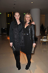 Left to right, AMY SACCO and ALICE KODELL at a Burns Night dinner in aid of cancer charity CLIC Sargent held at St.Martin's Lane Hotel, London on 25th January 2011.