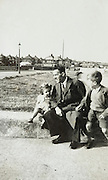 father with children in a new housing development England 1950