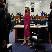 President Donald Trump's Supreme Court nominee Judge Amy Coney Barrett leaves for a lunch break during her Senate Judiciary confirmation hearing on Monday, October 12, 2020.