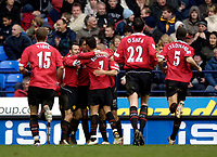 Photo: Jed Wee.<br />Bolton Wanderers v Manchester United. The Barclays Premiership. 01/04/2006.<br />Manchester United celebrate Ruud van Nistelrooy's winning goal.