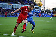 Walsall defender Nicky Devlin (6) heads clear from Peterborough United midfielder Siriki Dembele (10) during the EFL Sky Bet League 1 match between Peterborough United and Walsall at London Road, Peterborough, England on 22 December 2018.