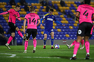 AFC Wimbledon midfielder Jack Rudoni (12) surrounded by Peterborough United players during the EFL Sky Bet League 1 match between AFC Wimbledon and Peterborough United at Plough Lane, London, United Kingdom on 2 December 2020.