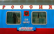 """Photo by Heathcliff Omalley..Ulan Ude - Khabarovsk  22 November 2007.A woman's face peers through the window of a """" Rossiya"""" Trans Siberian railway carriage."""