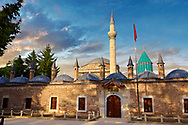 The outer wall will small domed Dervish lodges of the Mevlâna museum,  the mausoleum of Jalal ad-Din Muhammad Rumi, a Sufi mystic also known as Mevlâna or Rumi. It was also the dervish lodge (tekke) of the Mevlevi order, better known as the whirling dervishes. Mevlâna died on 17 December 1273. Konya, Turkey