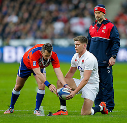 After going to the TMO for a Dan Cole try referee Nigel Owens takes the ball from England Inside Centre Owen Farrell who prepares to take the conversion - Mandatory byline: Rogan Thomson/JMP - 19/03/2016 - RUGBY UNION - Stade de France - Paris, France - France v England - RBS 6 Nations 2016.