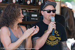 """Roland Sands hosts the awards ceremony for the """"Built for the Ride"""" bike show presented by RSD along with his sister, Summer Hoover, in City Park during the 75th Annual Sturgis Black Hills Motorcycle Rally.  SD, USA.  August 1, 2015.  Photography ©2015 Michael Lichter."""