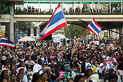 © Licensed to London News Pictures. 05/01/2014. A Large group of Anti-Government at a Rally during the third day of the 'Bangkok Shutdown' as anti-government protesters continue with their 'shutdown' of Bangkok.  Major intersections in the heart of the city have been blocked in their campaign to oust Prime Minister Yingluck Shinawatra and her government in Bangkok, Thailand. Photo credit : Asanka Brendon Ratnayake/LNP