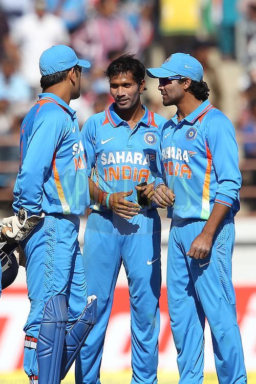 Ashok Dinda of India celebrates the wicket of Eoin Morgan of England during the 1st Airtel ODI Match between India and England held at the SAURASHTRA CRICKET ASSOCIATION STADIUM, RAJKOT, India on the 11th January 2013..Photo by Ron Gaunt/BCCI/SPORTZPICS ..Use of this image is subject to the terms and conditions as outlined by the BCCI. These terms can be found by following this link:..http://www.sportzpics.co.za/image/I0000SoRagM2cIEc