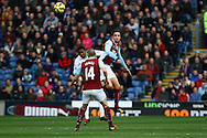 Everton's Samuel Eto'o and Burnley's Michael Duff jump for the ball. Barclays Premier league match, Burnley v Everton at Turf Moor in Burnley, Lancs on Sunday 26th October 2014.<br /> pic by Chris Stading, Andrew Orchard sports photography.