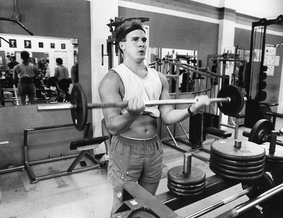©1987 man working out at small health club, Austin, Texas