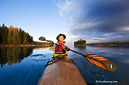 Kayaker on Lower Stillwater Lake near Whitefish Montana model released
