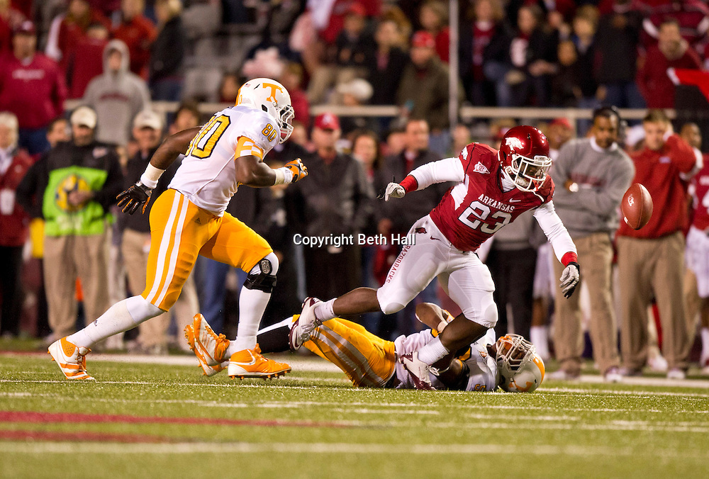 Nov 12, 2011; Fayetteville, AR, USA;  Tennessee Volunteers defensive lineman Corey Miller (80) looks on as linebacker Curt Maggitt (56) brings down Arkansas Razorbacks running back De'Anthony Curtis (23) causing a fumble during a game at Donald W. Reynolds Razorback Stadium. Arkansas defeated Tennessee 49-7. Mandatory Credit: Beth Hall-US PRESSWIRE