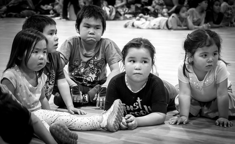 Children watching the music player.