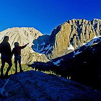 BACKPACKING, Sierra Nevada, CA. Family hikers (MR) in Big Pine Cyn., John Muir Wild. Temple Crag bkg.