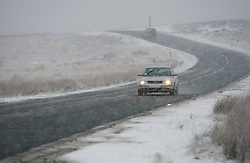 © Licensed to London News Pictures. 14/01/2013..North Yorkshire Moors, England..A motorist drives through the start of heavy snow fall on the North Yorkshire Moors...Photo credit : Ian Forsyth/LNP