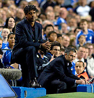 Photo: Daniel Hambury.<br /> Chelsea v Barcelona. UEFA Champions League, Group A. 18/10/2006.<br /> Barcelona's coach Frank Rijkaard (L) and Chelsea coach Jose Mourinho.
