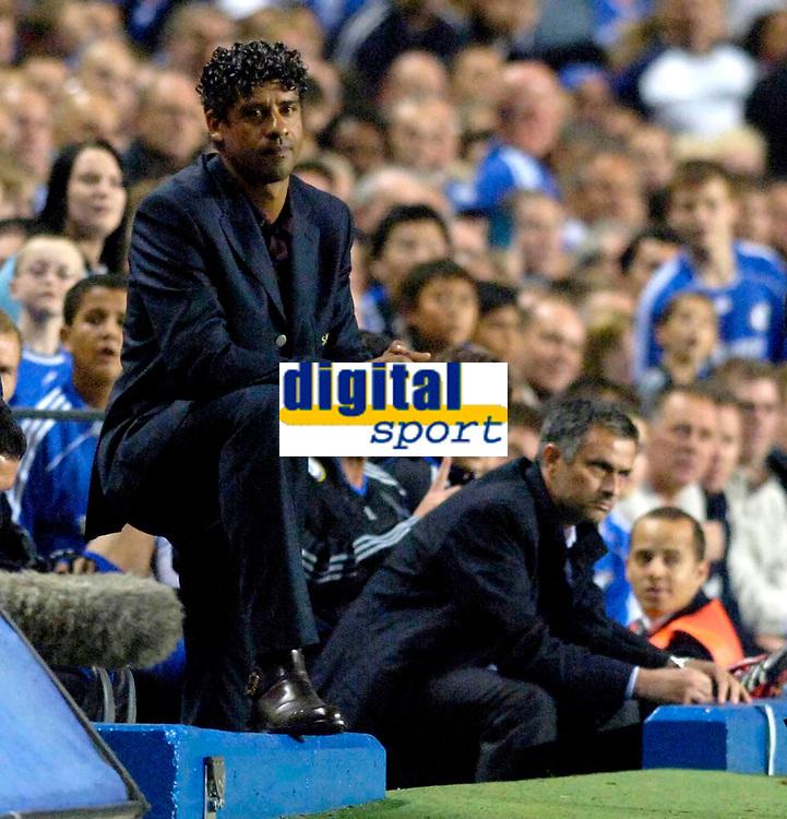 Photo: Daniel Hambury.<br /> Chelsea v Barcelona. UEFA Champions League, Group A. 18/10/2006.<br /> Barcelona's coach Frank Rijkaard (L) and Chelsea coach Jose Mourinho.