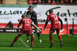 Ospreys' Jeff Hassler is tackled by Scarlets' Hadleigh Parkes - Mandatory by-line: Craig Thomas/Replay images - 26/12/2017 - RUGBY - Parc y Scarlets - Llanelli, Wales - Scarlets v Ospreys - Guinness Pro 14