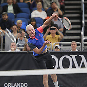 Tennis champion John McEnroe serves the ball during the PowerShares Tennis Series event at the Amway Center on January 5, 2017 in Orlando, Florida. (Alex Menendez via AP)
