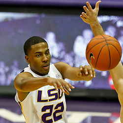 January 2, 2012; Baton Rouge, LA; LSU Tigers guard Ralston Turner (22) passes the ball past Virginia Cavaliers guard Joe Harris (12) during the second half of a game at the Pete Maravich Assembly Center. Virginia defeated LSU 57-52.  Mandatory Credit: Derick E. Hingle-US PRESSWIRE