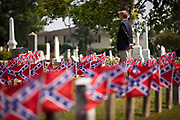 A member of the Palmetto Guard stands for a moment of silence for Confederate soldiers killed during the US Civil War at Magnolia Cemetery to mark Confederate Memorial Day on May 10, 2011 in Charleston, South Carolina.  South Carolina is one of three states that marks the day as a public holiday.