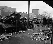 Car Bomb Damage in Dublin (E10)..1972.02.12.1972..12.02.1972..2nd December 1972..On the morning of 2nd December '72 two car bombs exploded in Dublin City. At Sackville Place two busmen were killed as they waited in their car to resume work. The busmen were named as George Bradshaw (30) and Thomas Duffy (23). The bomb was thought to be planted by a Northern Ireland subversive group who hoped to influence legislation going through Dail Eireann in relation to the I.R.A...A scene of devastation,looking from liberty Hall up towards O'Connell Street.