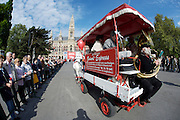 Maiaufmarsch (Labour Day March) in front of Vienna's City Hall of the SPOE (Social Democratic Party of Austria). Horse carriage with tuba player.