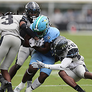 ORLANDO, FL - OCTOBER 24:  Running back Stephon Huderson #5 of the Tulane Green Wave gets stopped by defensive back Jermaine McMillian #26 and defensive back Antwan Collier #3 of the Central Florida Knights at Bounce House-FBC Mortgage Field on October 24, 2020 in Orlando, Florida. (Photo by Alex Menendez/Getty Images) *** Local Caption *** Stephon Huderson; Jermaine McMillian; Antwan Collier