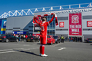 A young Wales fan arrives at the ground ahead of the UEFA European 2020 Qualifier match between Wales and Slovakia at the Cardiff City Stadium, Cardiff, Wales on 24 March 2019.