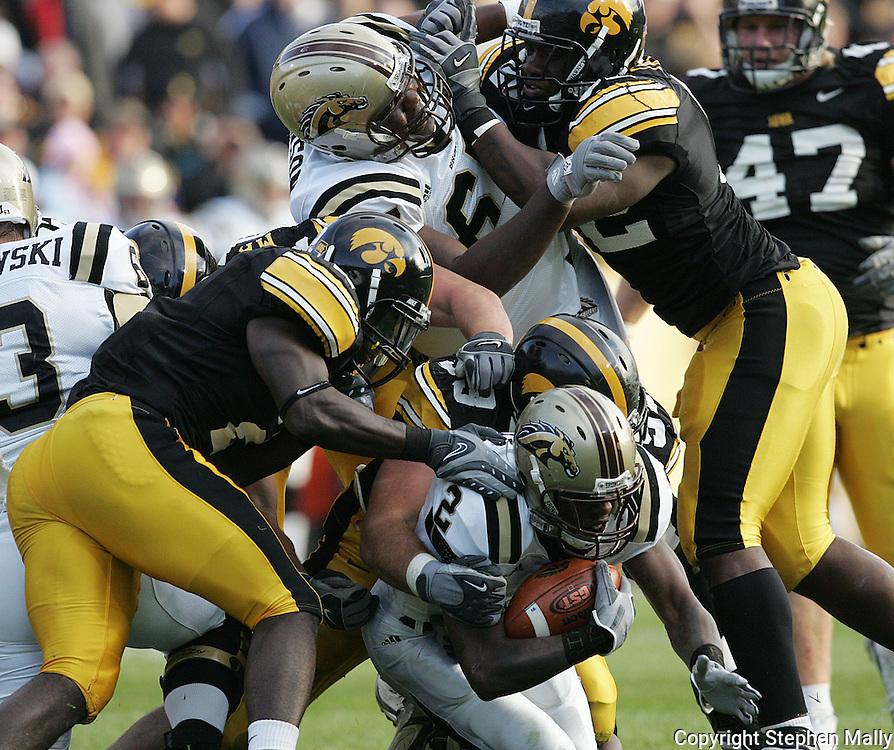 17 NOVEMBER 2007: Western Michigan running back Brandon West (2) is brought down by Iowa defensive end Bryan Mattison (99) in Western Michigan's 28-19 win over Iowa at Kinnick Stadium in Iowa City, Iowa on November 17, 2007.