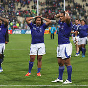 Dejected Samoan players at the end of the game during the South Africa V Samoa, Pool D match during the IRB Rugby World Cup tournament. North Harbour Stadium, Auckland, New Zealand, 30th September 2011. Photo Tim Clayton...