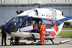 Prince George and Princess Charlotte explore a rescue helicopter as they visit Airbus in Hamburg, Germany with their parents, the Duke and Duchess of Cambridge.