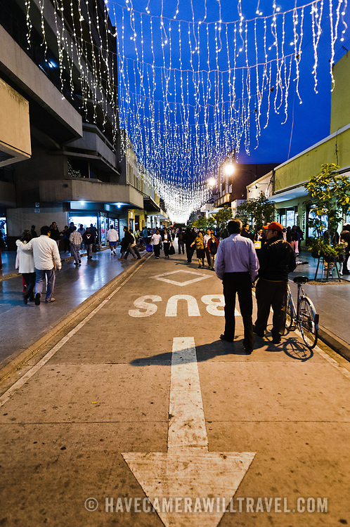 The Calle Real (6th Avenue) pedestrian shopping street in downtown Guatemala City at dusk